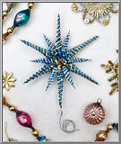 Filigree Tinsel Star in blue and gold