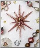Filigree Tinsel Star in pink and gold