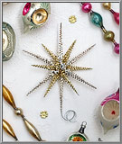 Filigree Tinsel Star in gold and silver